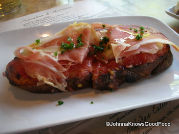 An open face sandwich of Jamon Serrano and manchego cheese,
