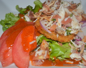 Aqua Fried Green Tomatoes BLT Salad topped with Local Crabmeat