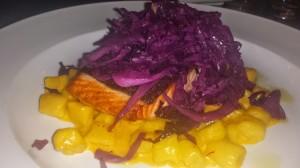 Salmon, gnocchi, saffron cream sauce, & sauteed red cabbage